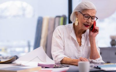 Older woman works at a desk
