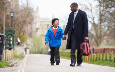 Father with flexible working walking son to school