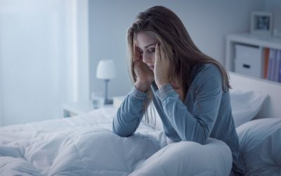 woman in bed on long-term sick leave from work
