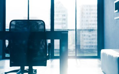 desk chair and empty desk in office as employee on unauthorised absence