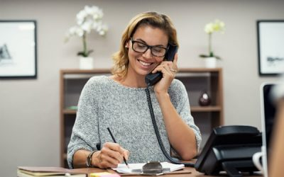 Woman smiling on office phone