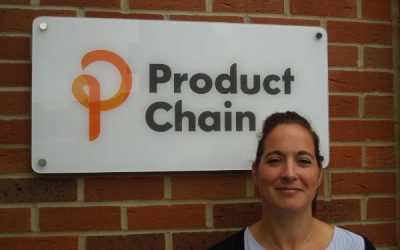 Louise stands in front of a Product Chain sign
