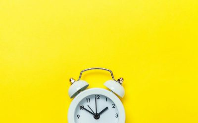 Alarm clock against a yellow background