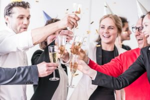Staff celebrating with champagne at office christmas party