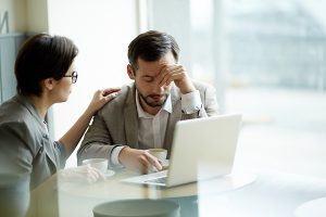 Employer consoling bereaved employee going on compassionate leave