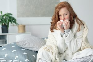 Woman with cold off work on short term sick leave