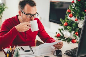 man in office at Christmas planning annual leave